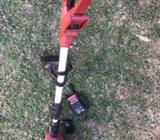 Ozito Cordless grass trimmer with charger included