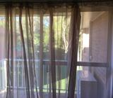 Beige sheer curtains in fantastic condition with curtain rod