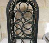 7 bottle wine rack, wrought iron, in great condition