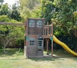 Two storey cubby with swings, slide &'rock' climbing