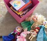 Assortment of various kids books and 5 dolls