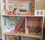 tall and sturdy dolls house with people